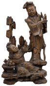 A Chinese 19th C. carved hardwood figure of two Immortals