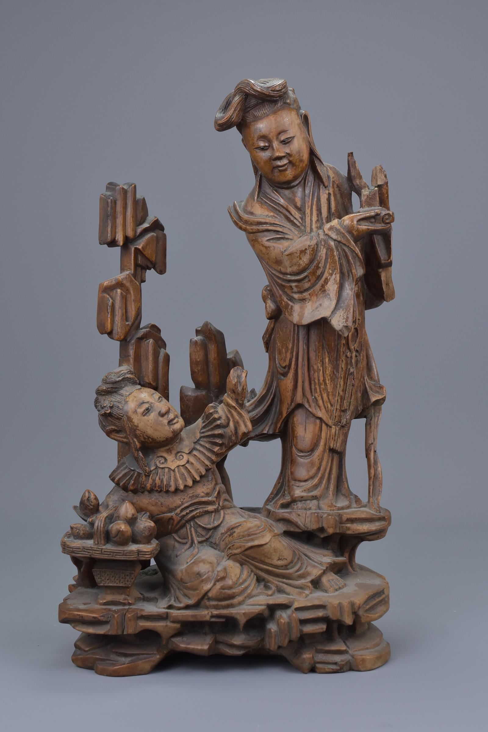 Lot 42 - A Chinese 19th C. carved hardwood figure of two Immortals
