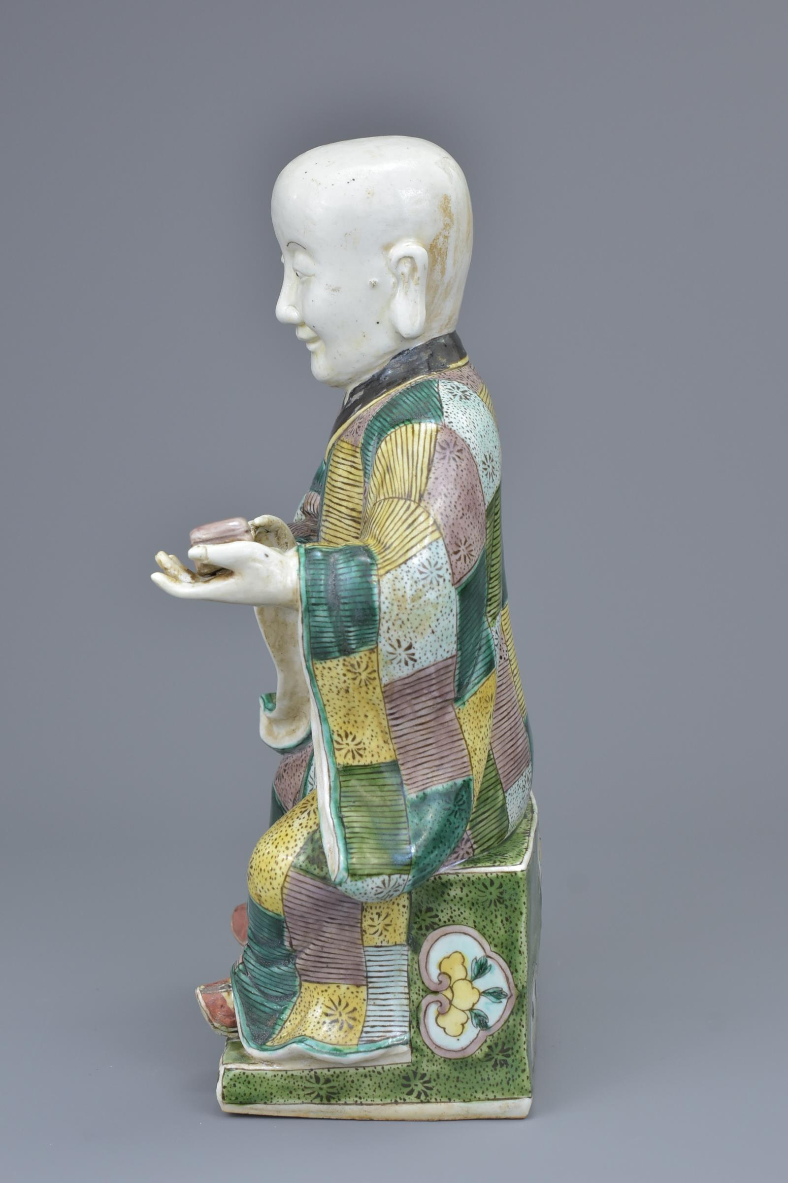 Lot 35 - A Chinese 19th C. Famille verte porcelain figure of a 'doctor'