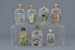A group of seven Chinese glass painted snuff bottles
