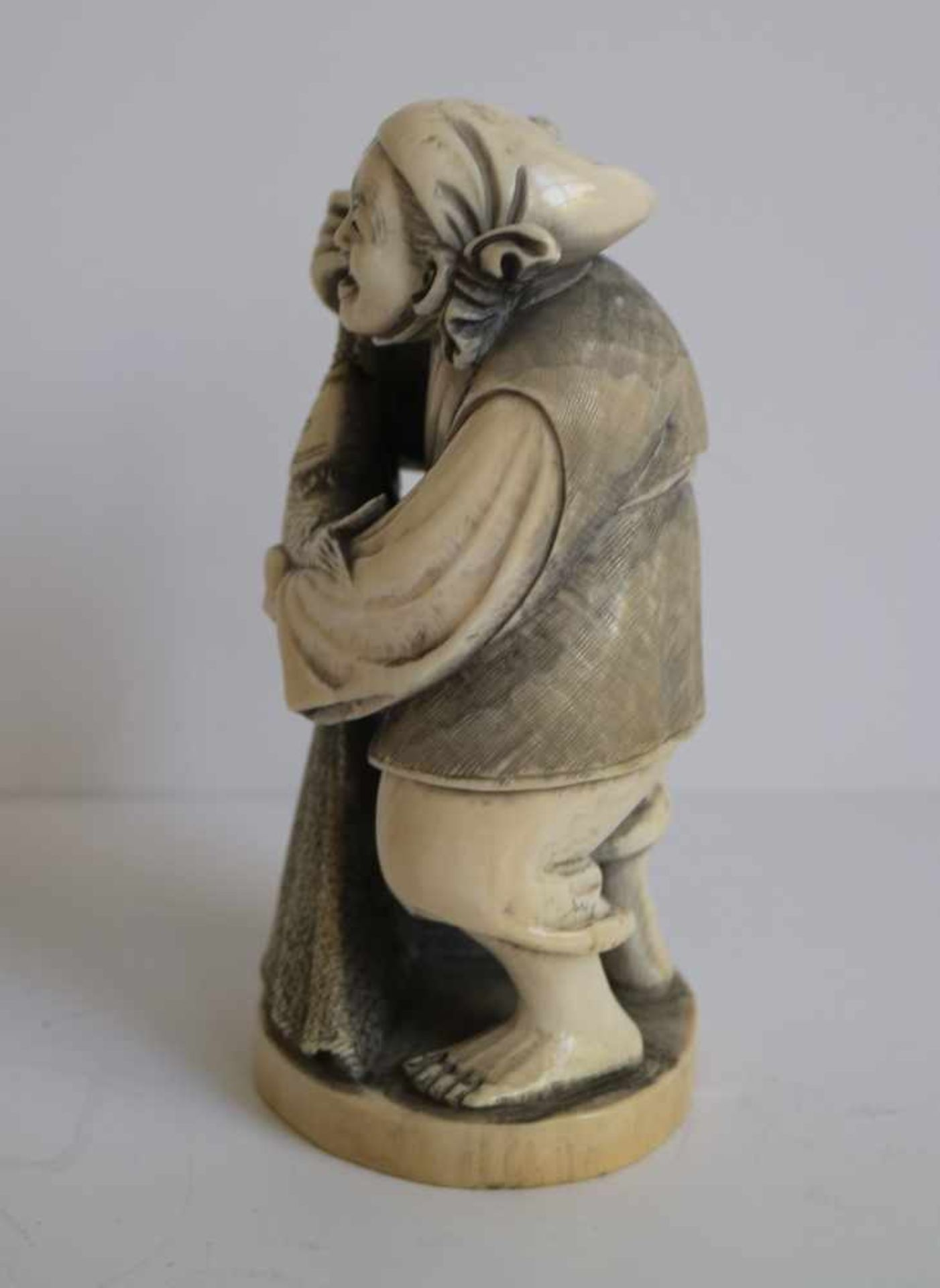 Los 708 - Ivory Okimono Depicting Ebisu holding his catch, Japan H 11,3 cm signed