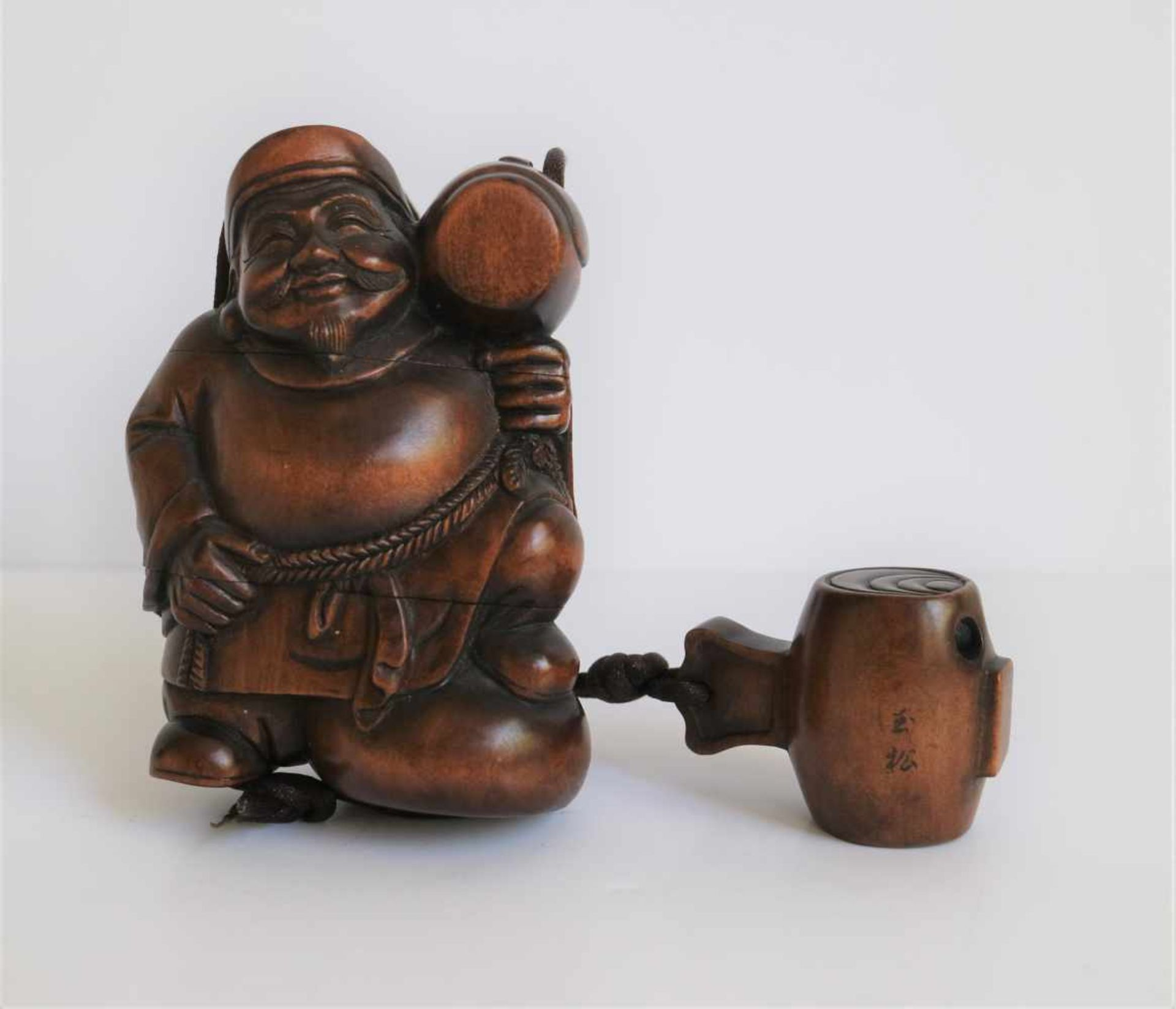 Los 707 - Wooden 3 section inro depicting Daikoku Daikoku, God of thunder holding his mallet, Japan 20th