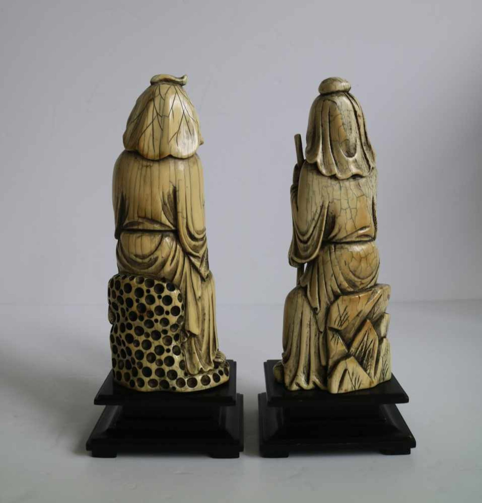 Los 670 - A pair of mammoth ivory arhats China 1970's H 24 cm (with base)