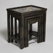 Set of Chinese lacquered wood nest tables with stone and mother of pearl inlay