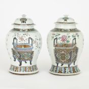 Near pair of Chinese porcelain vases with lids