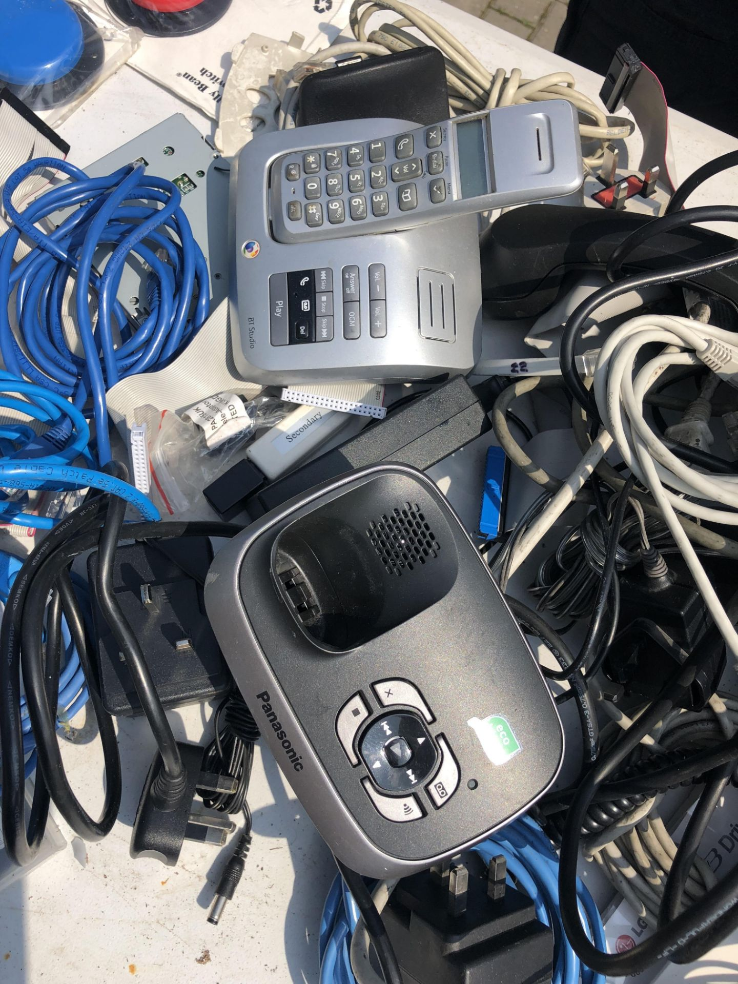 Lot 468 - JOB LOT OF OFFICE EQUIPMENT INCLUDES PHONES MODEMS ETHERNET CABLES LAPTOP CHARGERS ETC