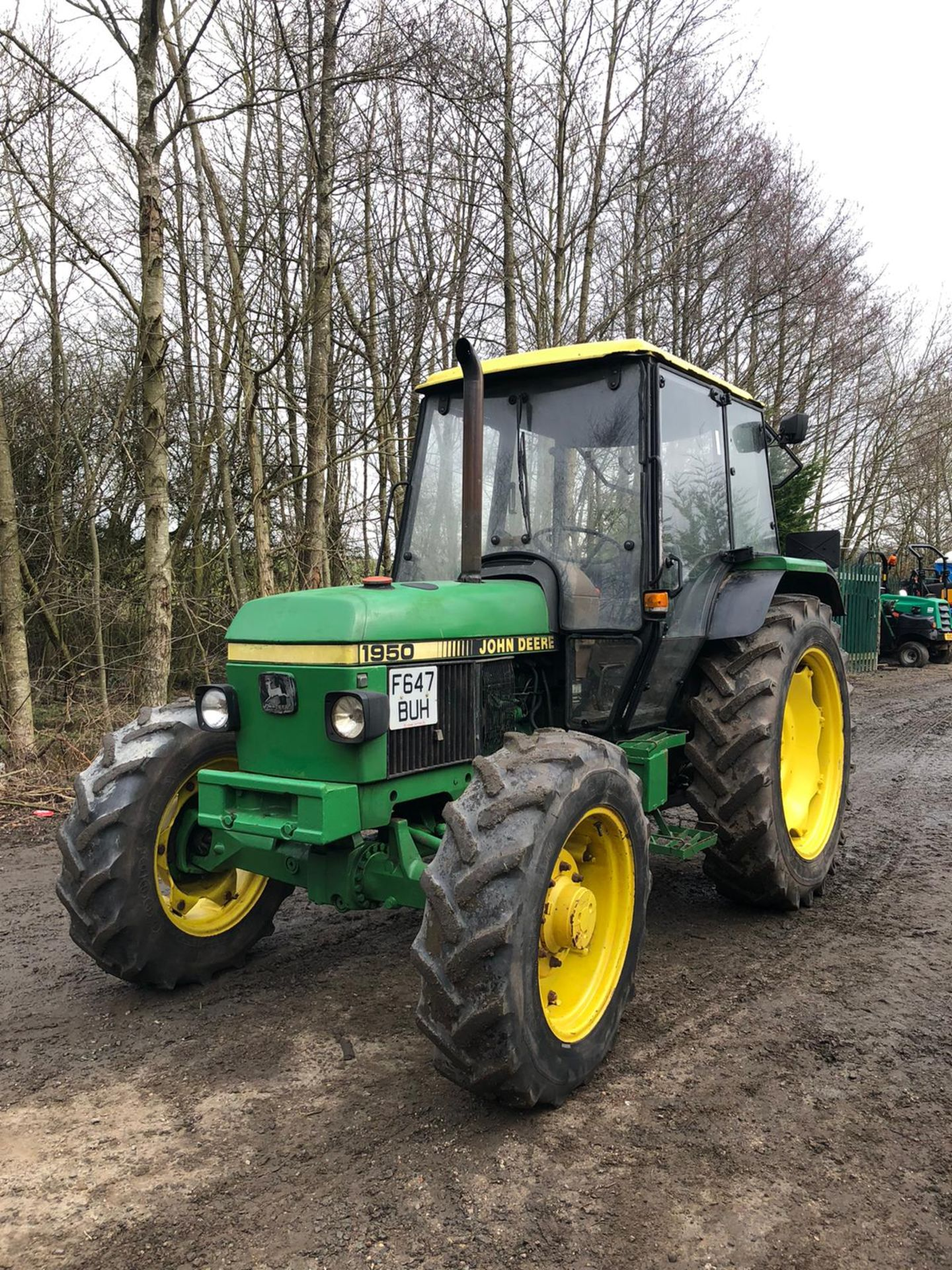 Lot 42 - JOHN DEERE 1950 TRACTOR, 4 WHEEL DRIVE, FULL GLASS CAB, RUNS, WORKS, DOES EVERYTHING IT SHOULD
