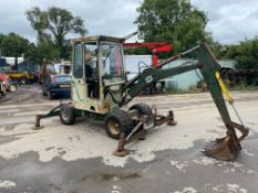 SMC 2.5 WHEELED MINI DIGGER, PIPED FOR BREAKER, FULL HEATER CAB, DOOR HINGE BROKEN BUT IS PRESENT