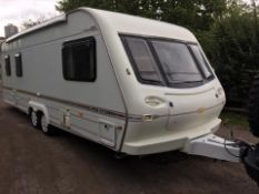 ELDDIS CRUSADER SUPER STORM TWIN AXLE TOWABLE 4 BERTH CARAVAN, AIR CON, AWNINGS, PORCH *NO VAT*