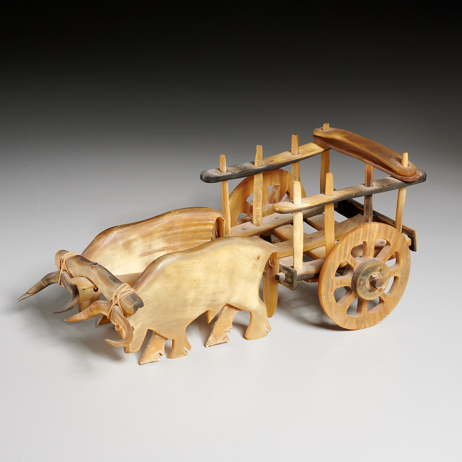 Lot 2317 - American Folk horn oxen and cart, published