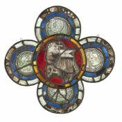 A PROBABLY FRENCH MEDIEVAL STAINED GLASS WINDOW WITH AGNUS DEI, c. 1400. Clear glass with black
