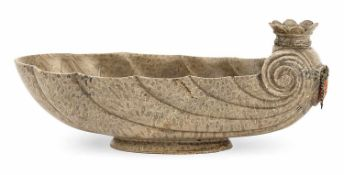 A BAROQUE CUT GRAY SERPENTINE STONE SHELL SHAPED FOOTED BOWL, late 17th century. At the back a