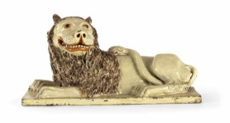 A BIG RECUMBAND GLAZED TERRACOTTA LION, probably pottery workshop of Michael Schroeck, Mariakirchen,