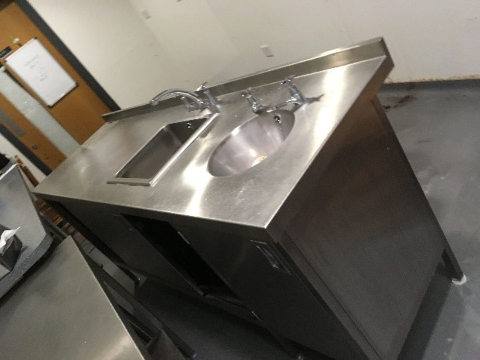 Lot 4 - Stainless steel sink unit with cupboards