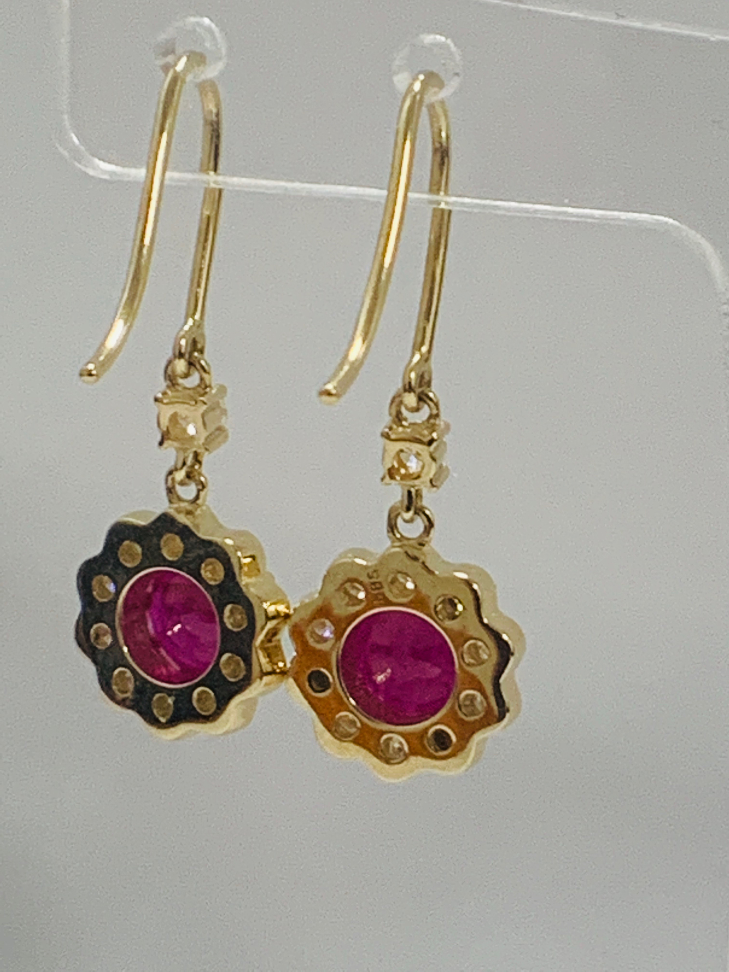 Lot 69 - 14ct Yellow Gold Ruby and Diamond earrings featuring, 2 round cut, red Rubies (2.22ct TSW)