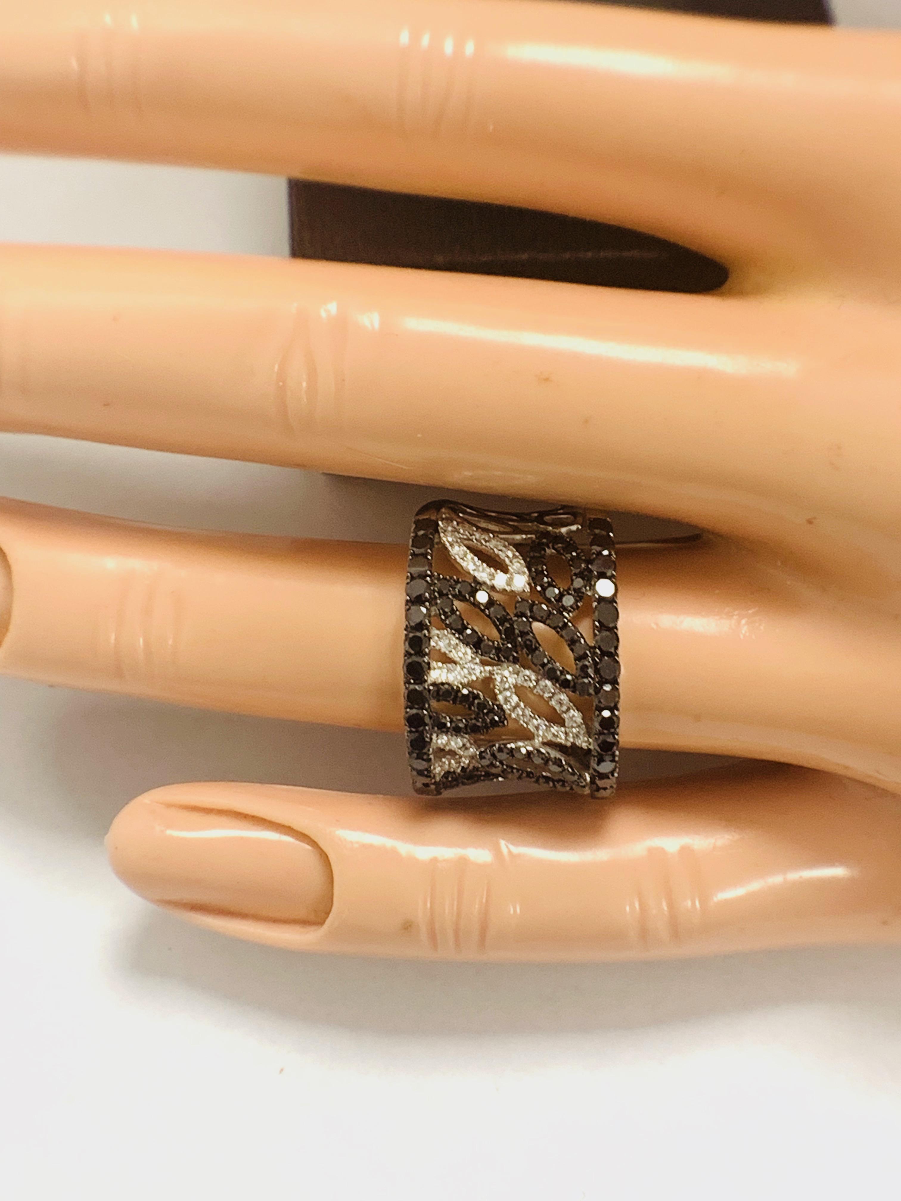 Lot 55 - 18ct White Gold Diamond ring featuring 90 round cut, black Diamonds (1.14ct TBDW)