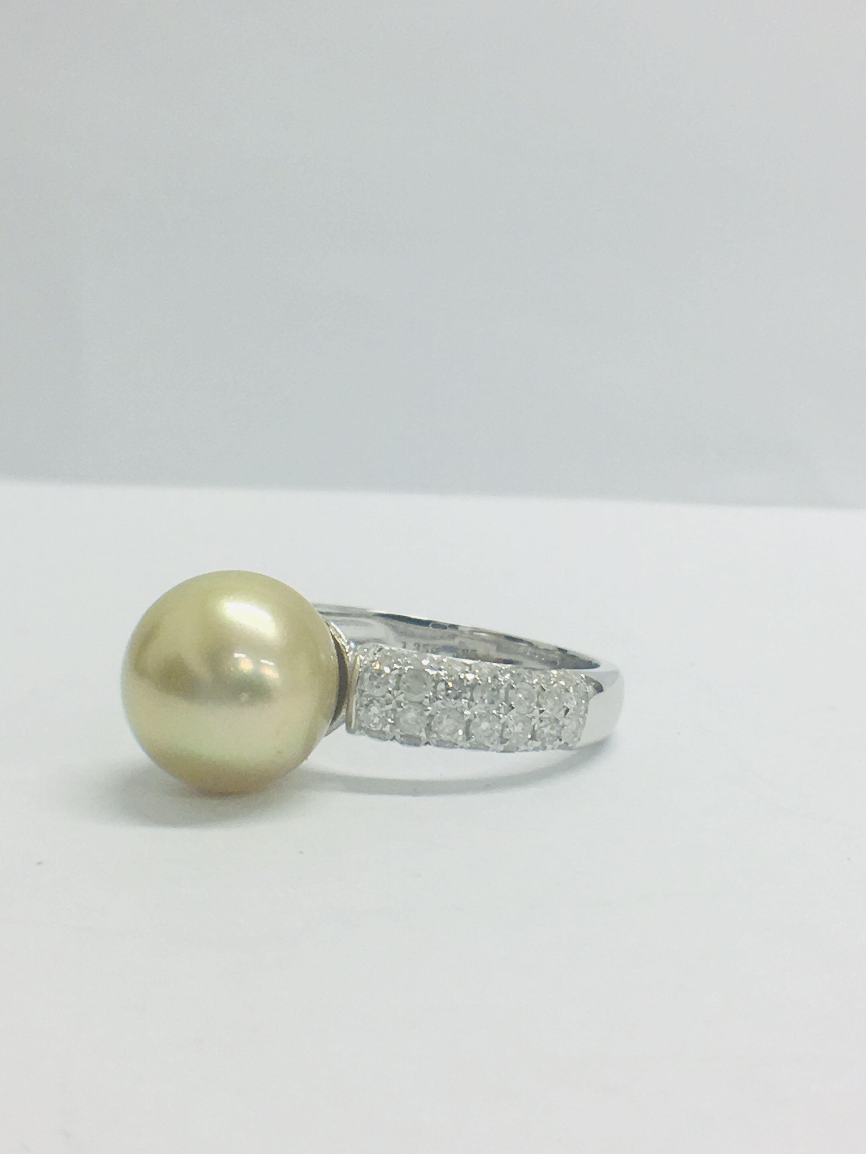 Lot 21 - 14ct white gold pearl & diamond ring.