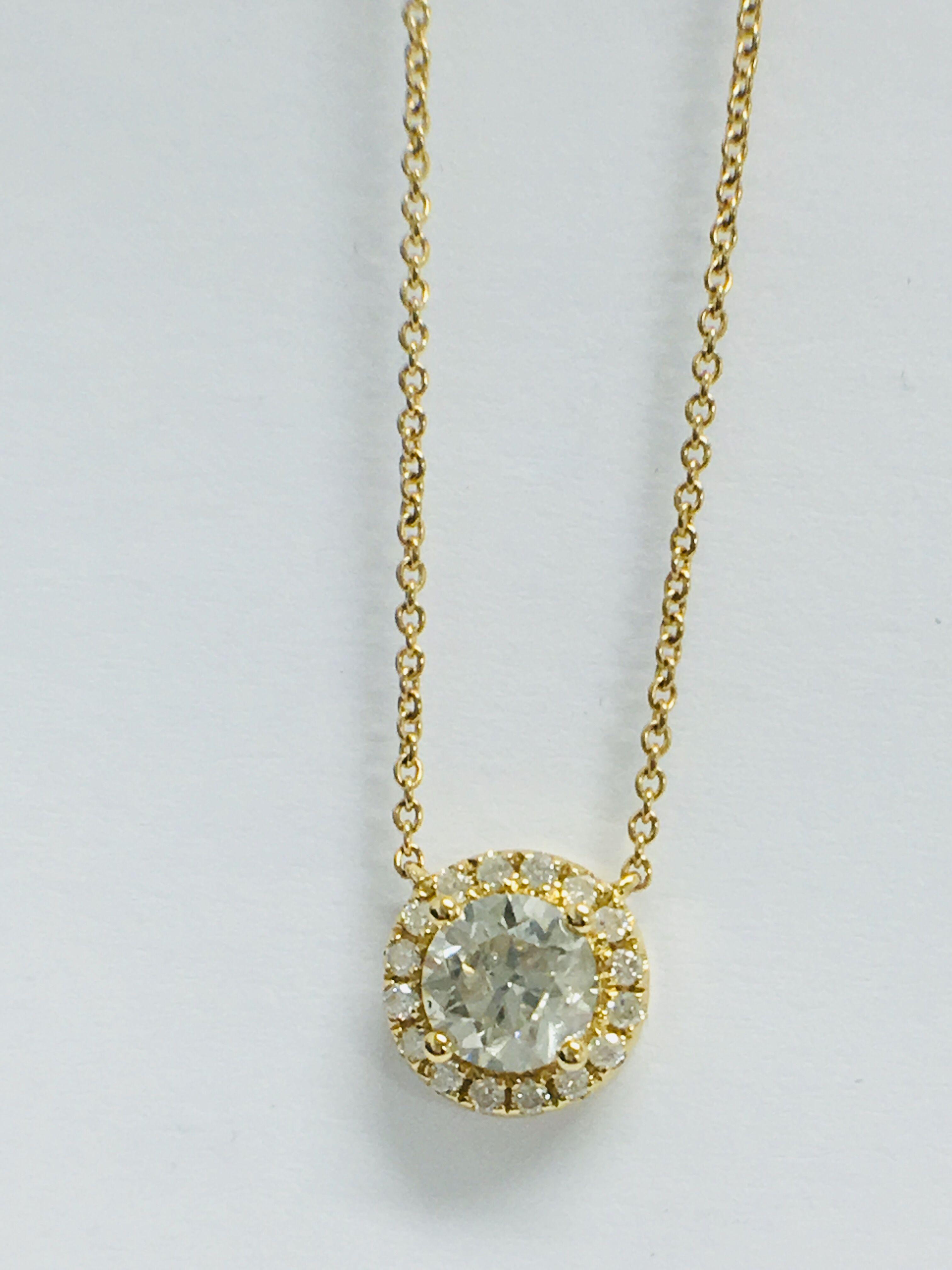 Lot 18 - 18ct yellow gold diamond necklace. tdw.