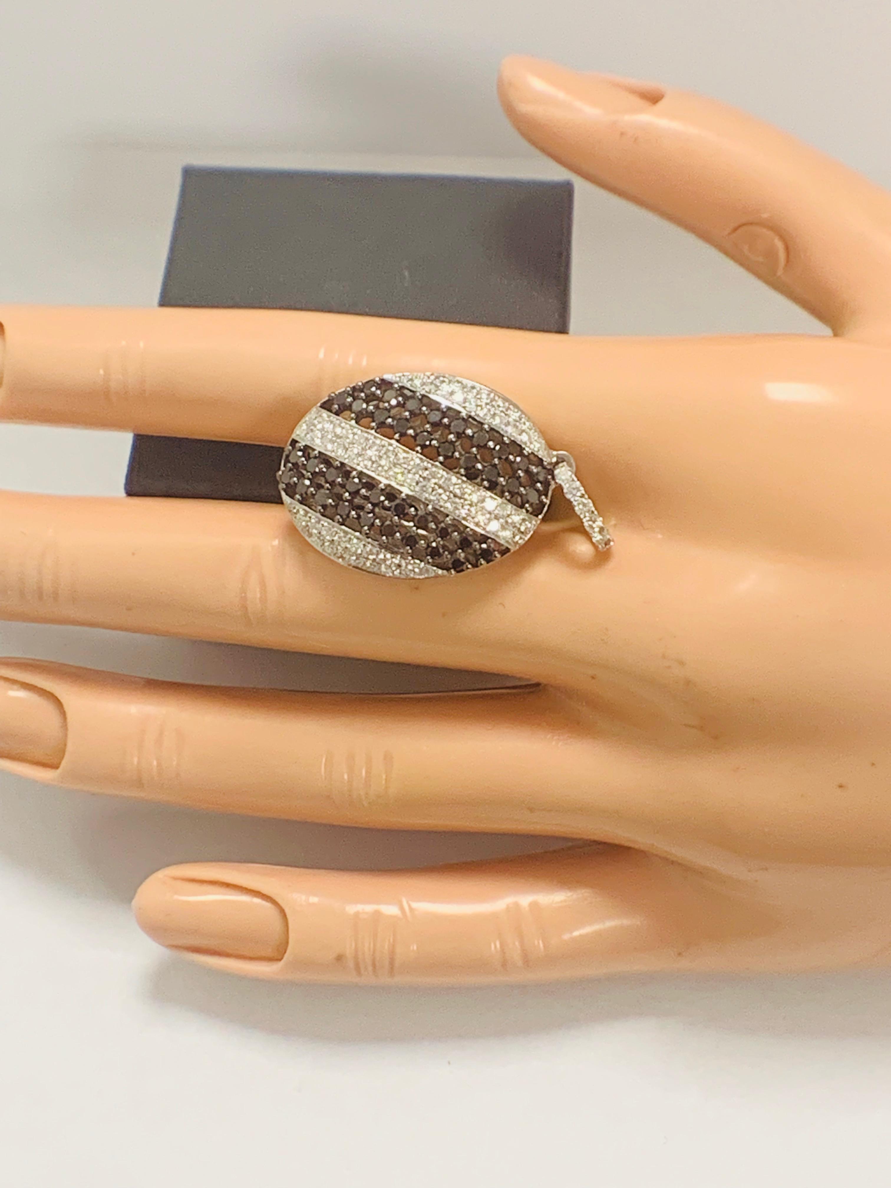 Lot 58 - 18ct White Gold Diamond pendant featuring 38 round cut, black Diamonds (0.95ct TBDW)