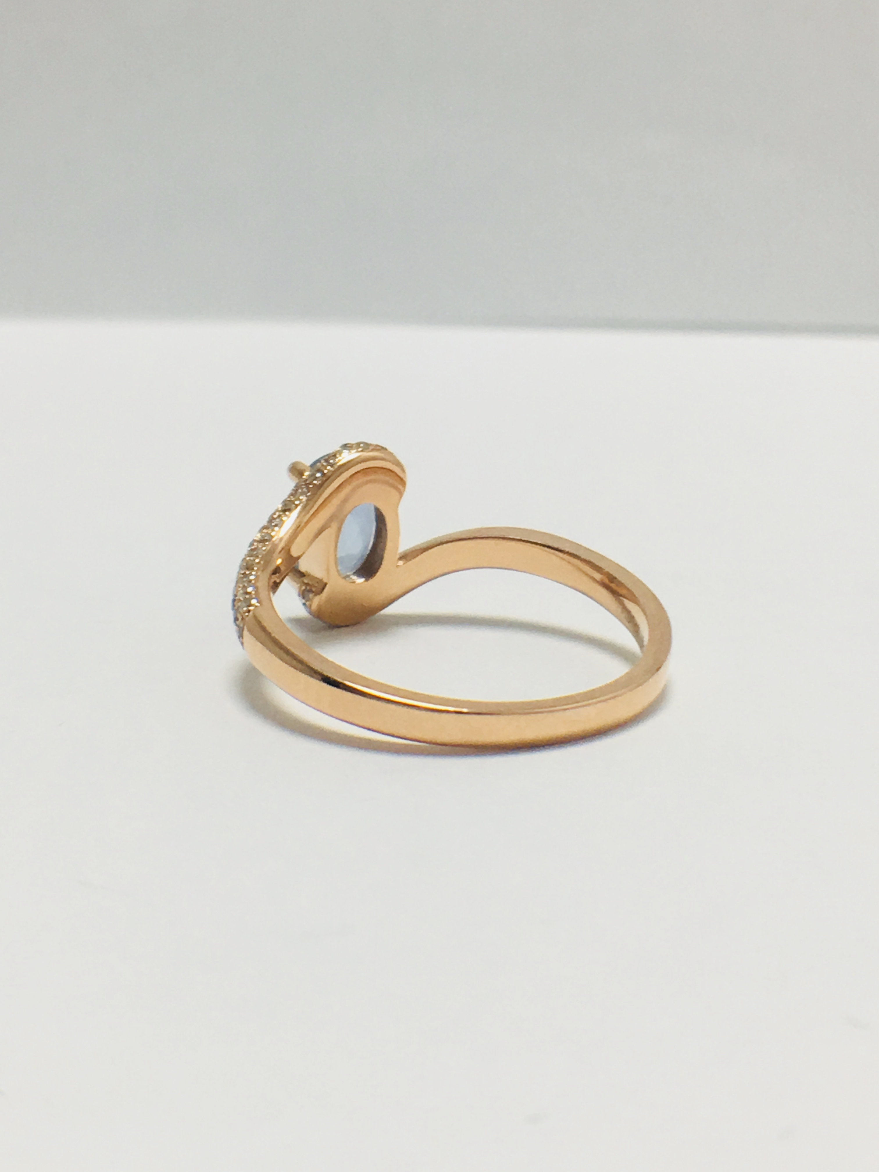 Lot 12 - 14ct rose gold sapphire and diamond ring