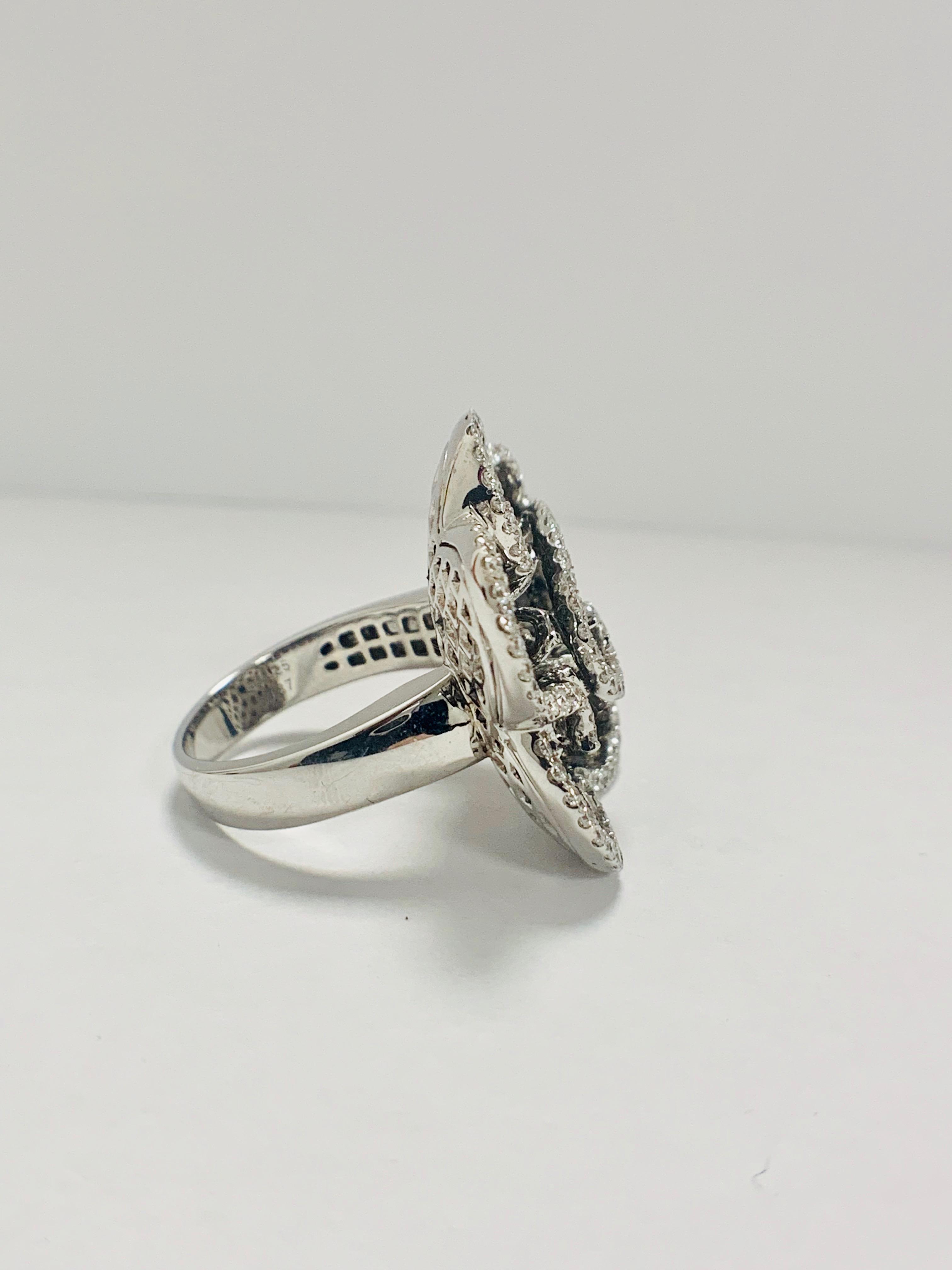 Lot 56 - 18ct White Gold Diamond flower design ring featuring 123 round cut, black Diamonds (2.25ct TBDW)