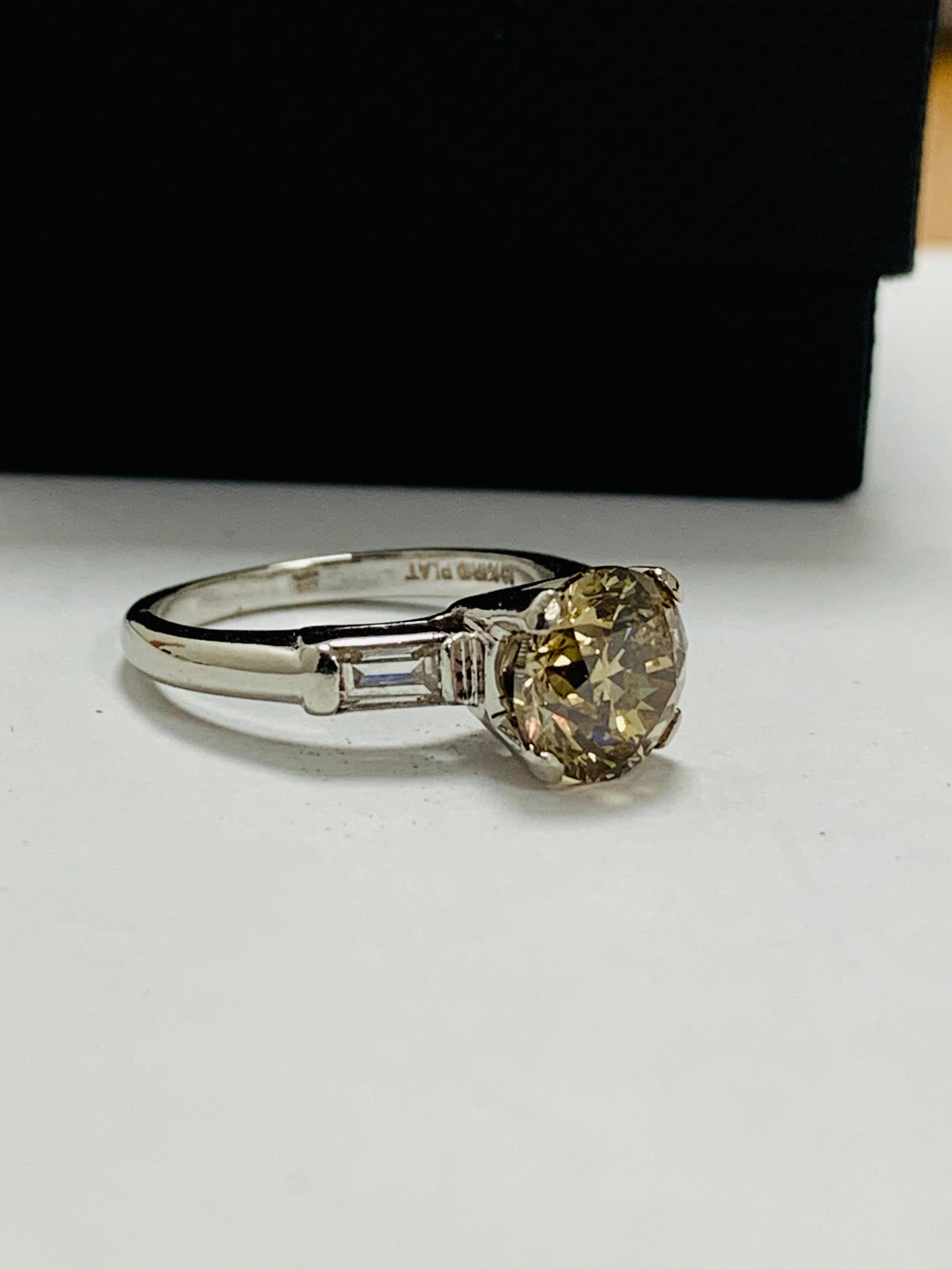 Lot 39 - 14ct white gold diamond ring.