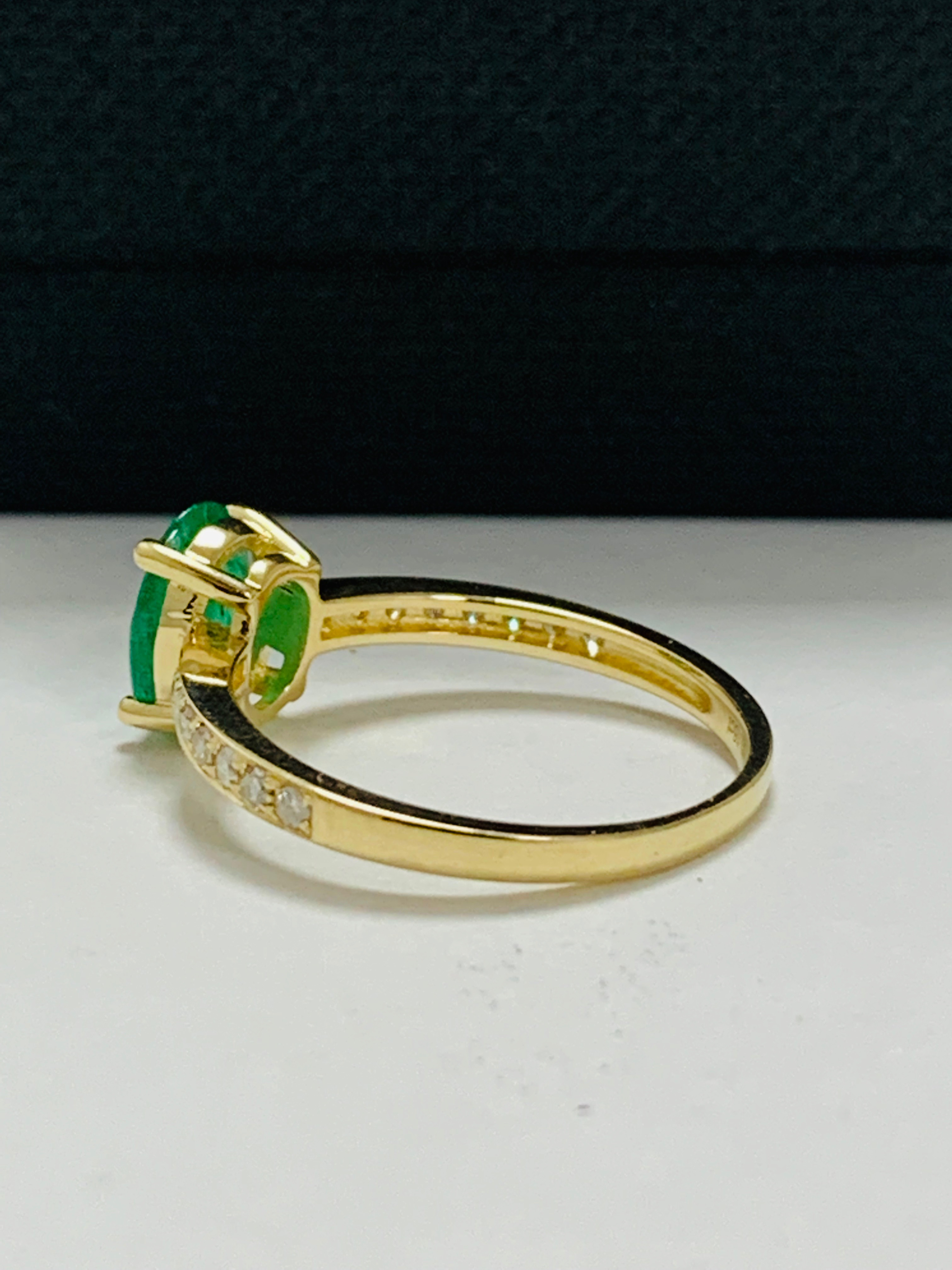 Lot 41 - 14ct yellow gold emerald and diamond ring