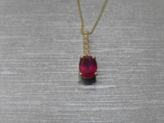 0.80Ct Ruby And Diamond Drop Style Pendant.