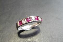 Ruby And Diamond Eternity Band Ring Set In 9Ct White Gold.