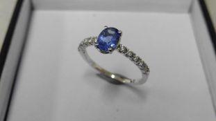 0.80Ct / 0.12Ct Tanzanite And Diamond Dress Ring.