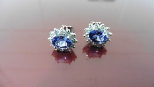 1.60Ct Tanzanite And Diamond Cluster Style Stud Earrings.