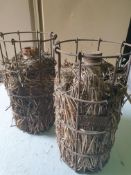 2 Vintage Glass bottle wrapped in straw in metal cage