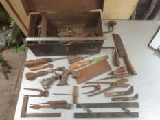 Metal box with selection of vintage tools