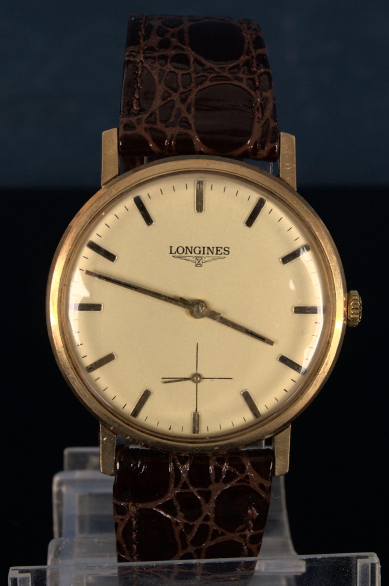 """LONGINES"" - Elegante, goldene Herrenarmbanduhr der Marke Longines. Gehäuse in 18 K Gelbgold,"