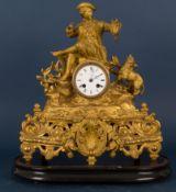 Antike Kaminuhr von Jäger bekrönt, goldbronzierter Metallguss auf ebonisiertem, ovalem Sockel,