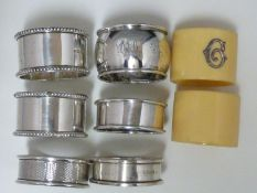 Six silver napkin rings, various dates and makers; and two celuloid napkin rings set with silver