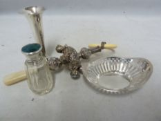 Four silver items, comprising an enamell an silver topped scent cut glass bottle; a pierced ring