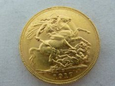 A gold Sovereign coin, dated 1917, 7.98grms approx