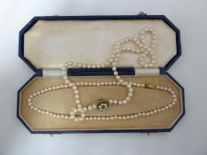 Two strings of cultured pearls with a 14ct yellow gold clasp, stamped 585, with presentation case,