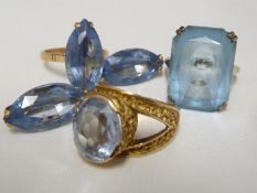 An aquamarine set ring, set in pierced yellow metal, stamped with Arabic marks; a marquise ring
