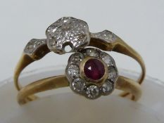 A ruby and diamond ring, the central ruby encircled by eight round brilliant cut stones set in an
