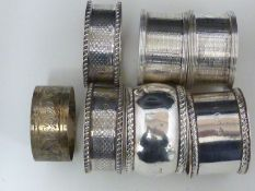 Seven silver napkin rings, including two pairs, various dates and makers, 190 grms approx (7)