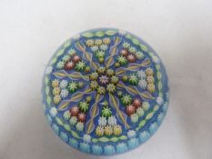 Perthshire - a glass paperweight, concentric millifiore canes interspersed with candy twist canes,