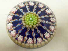 Perthshire- a glass paperweight, concentric millifiore canes interspersed with candy twist canes,