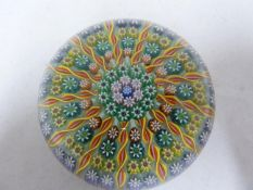 Perthshire - a glass paperweight, concentric millifiori interspersed with candy twist canes, 7.5cm