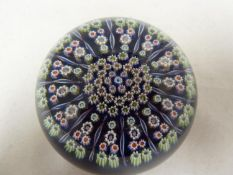 Perthshire - a glass paperweight, concentric millifiori canes interspersed with candy twist canes,