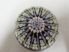 Perthshire - a glass paperweight, concentric millifiore canes, interspersed with candy twist