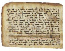 A KUFIC QURAN FOLIUM, ABBASID, 8TH-9TH CENTURY