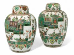 A PAIR OF CHINESE FAMILLE VERTE JARS AND COVERS, KANGXI (1662-1722)