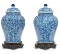 A LARGE PAIR OF CHINESE BLUE AND WHITE JARS AND COVERS, KANGXI PERIOD (1662-1722)